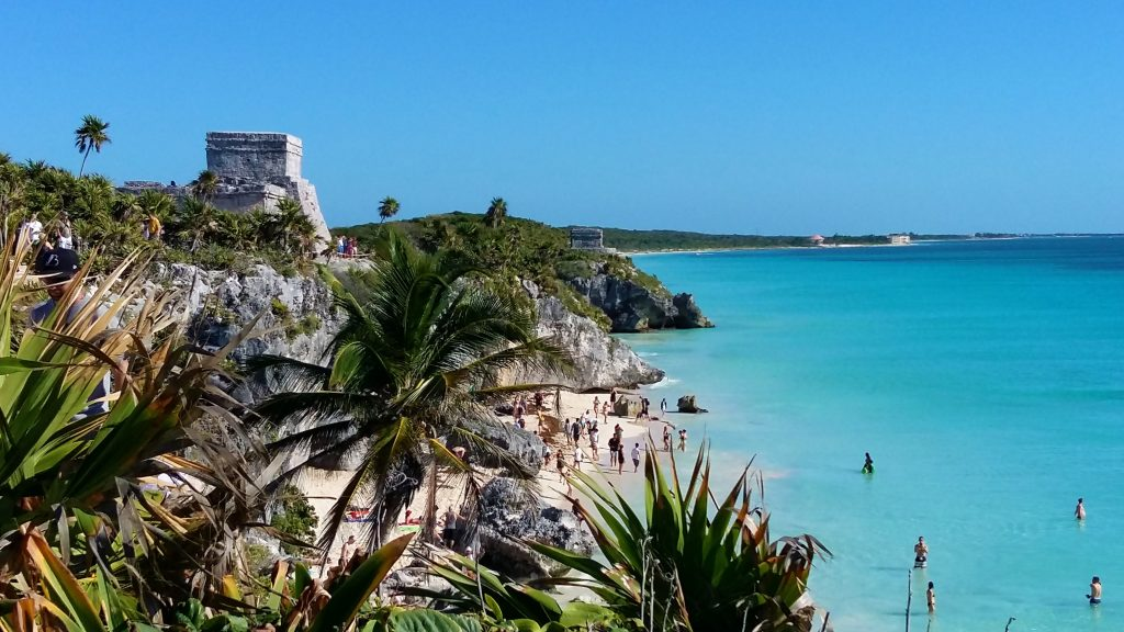 Take a Dip in the Sea by Tulum Ruins