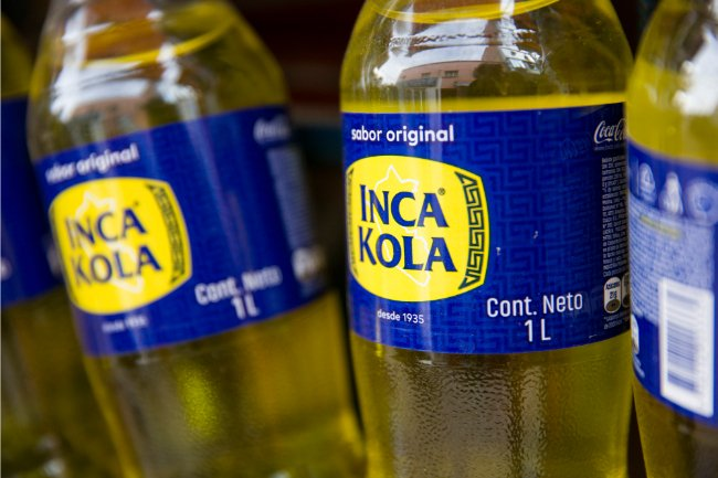 Drinks in Peru - The Luminous Inca Kola yellow liquid in bottle with blue and yellow label