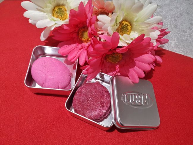 Lush Shampoo and Conditioner Bars - pink bars in square tins with pink flowers next to them