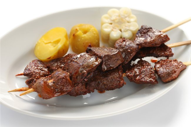 Peruvian Food You Must Try - Anticuchos - Beef Heart Grilled on a Skewer