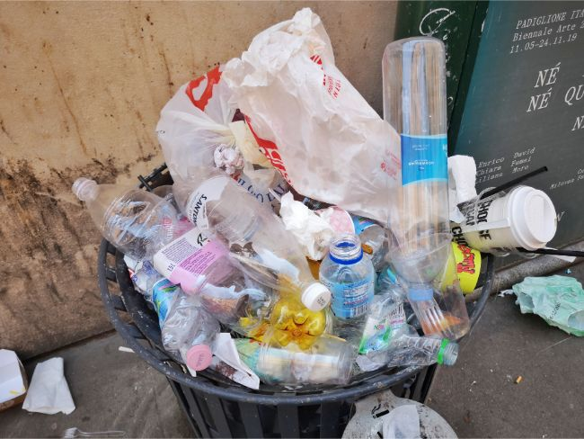 Plastic waste is a huge issue all over the world - bin overflowing with rubbish