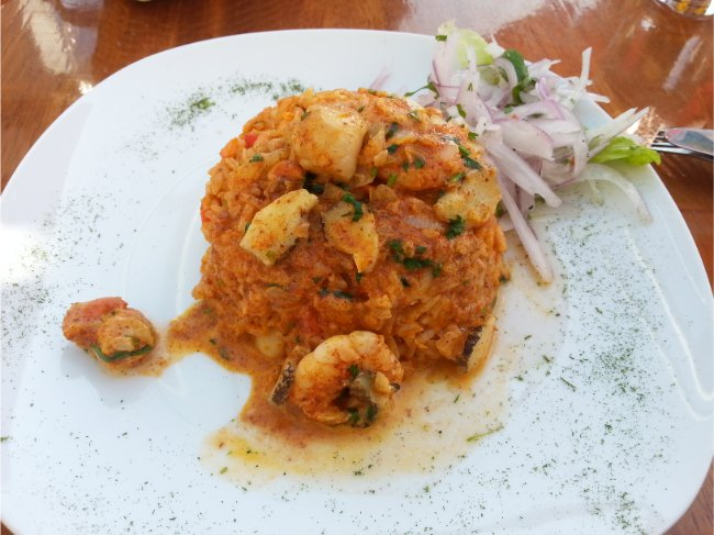 What to Eat in Peru - Seafood Chaufa Rice - Fried rice with prawns on a white plate