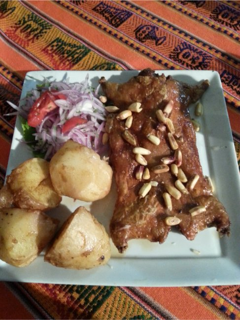 What to Eat in Peru - the poor little Guinea Pig (here without the head!)