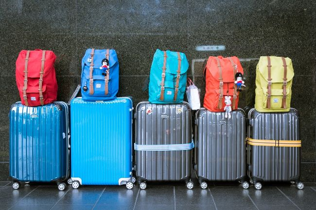 Rows of Luggage - Packing Light is Better for the Environment