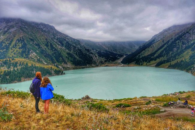 Almaty Kazahkstan has Penty to Offer Solo Female Travellers - Woman and Daughter looking out over a lake