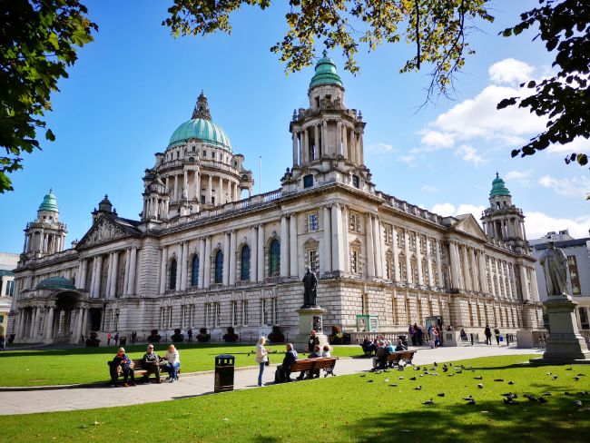 Belfast in Northern Ireland is a Great Choice for Solo Female Travellers - Impressive White Town Hall Building with blue sky in the background