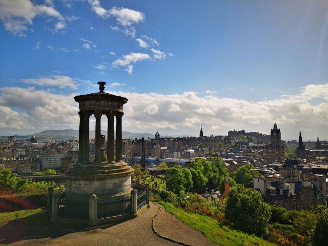 Edinburgh Scotland is Perfect for Solo Female Travellers - View of Edinburgh from Calton Hill with Monument in the foreground