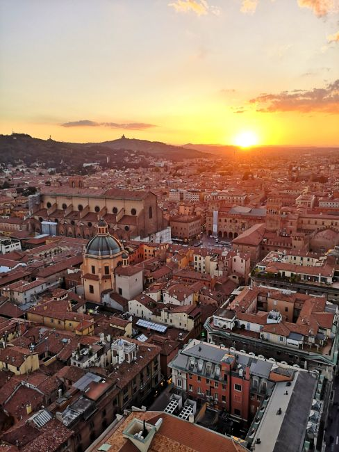 Foodies will Love Bologna Italy - Where to Travel Alone - The View of Bologna at Sunset from the Two Towers