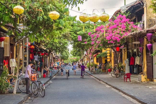 Hoi An Vietnam - One of the Best Places for Solo Female Travel in Asia - Street with hanging lanterns and pink flowers in hanging baskets
