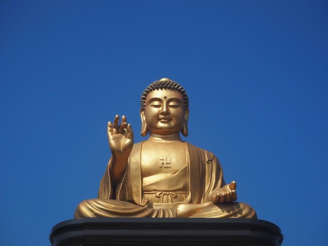 Kaohsiung Taiwan is a Wonderful Introduction to Asia for Solo Female Travellers - Gold Buddha statue against blue sky